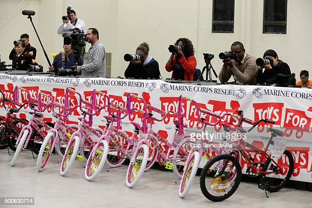 Members of the news media are stationed behind large shipping boxes as US first lady Michelle Obama delivers remarks before helping distribute...
