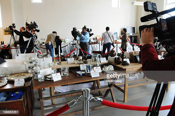 Members of the news media document household items during a media preview of the auction of personal property that once belonged to Bernard and Ruth...