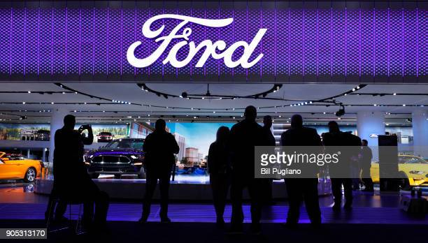Members of the news media stand around the entrance to the Ford Motor Company exhibit at the 2018 North American International Auto Show January 15...
