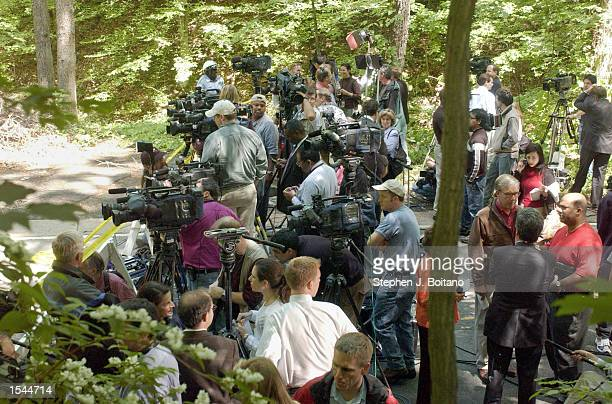 Members of the news media wait for a news conference in Rock Creek Park were Chandra Levy's skeletal remains were found May 22, 2002 in Washington...