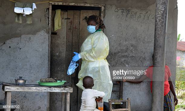 Members of the NGO U Fondation is about to enter a house where quarantined family members suffer from the Ebola virus on October 16 2014 in Monrovia...