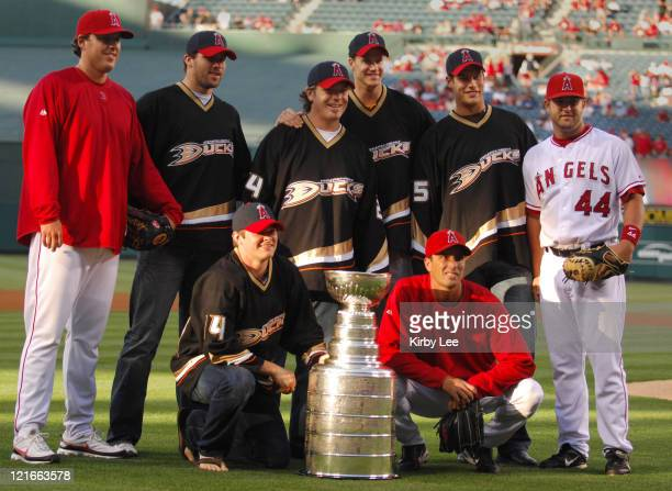 Members of the NHL Stanley Cupwinning Anaheim Ducks second left Dustin Penner Chris Kunitz kneeling Brad May Chris Pronger and Ryan Getzlaf pose with...