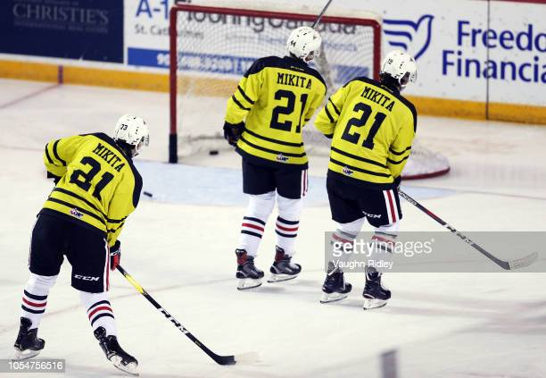 Members of the Niagara IceDogs wear special Stan Mikita jerseys during warm up prior to an OHL game against the Barrie Colts at Meridian Centre on...