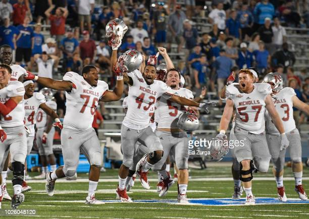 Members of the Nicholls State Colonels celebrate after a 2623 win in overtime against the Kansas Jayhawks in the second quarter at Memorial Stadium...