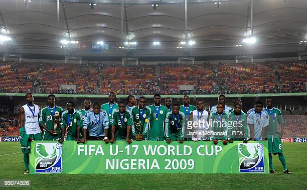 Members of the Nigeria team line up for a photo after defeat during the FIFA U17 World Cup Final match between Switzerland and Nigeria at the Abuja...