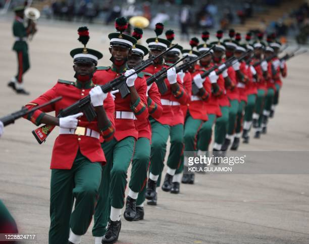 Members of the Nigerian Guards Brigade march at the Eagles Square in Abuja, Nigeria during the countrys 60th Independence Celebration on October 1,...