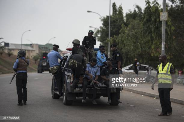 Members of the Nigerian police pursue protesters from the Islamic Movement of Nigeria in Abuja on April 17 2018 Nigerian police fired teargas for a...