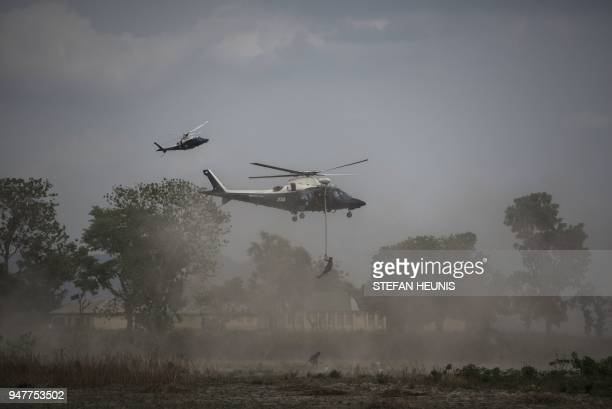 TOPSHOT Members of the Nigerian Special Forces Unit rappel from a helicopter during the African Land Forces Summit military demonstration held at...