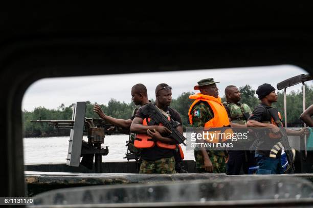 Members of the NNS Pathfinder of the Nigerian Navy forces are out on patrol looking for illegal oil refineries on April 19 2017 in the Niger Delta...