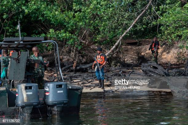 Members of the NNS Pathfinder of the Nigerian Navy forces beach at a site where an illegal oil refinery was run on April 19 2017 in the Niger Delta...