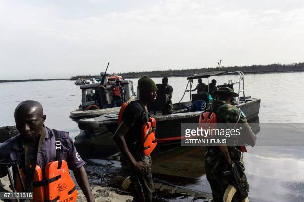 Members of the NNS Pathfinder of the Nigerian Navy forces go on patrol looking for illegal oil refineries on April 19 2017 in the Niger Delta region...