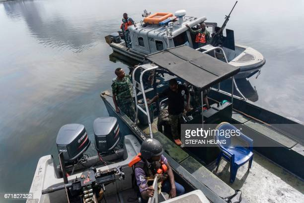 Members of the NNS Pathfinder of the Nigerian Navy patrol to look for illegal oil refineries on April 19 2017 in the Niger Delta region near the city...