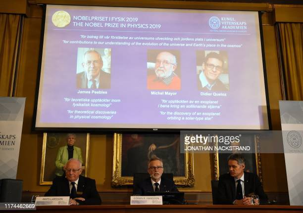 TOPSHOT Members of the Nobel Committee for Physics Chair of the Nobel Committee Mats Larsson Secretary General of the Academy Goran K Hansson and Ulf...
