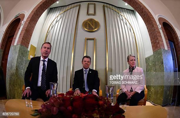 Members of the Nobel committee Olav Njoelstad and Berit ReissAndersen and Nobel Peace Prize laureate Colombian President Juan Manuel Santos attend a...