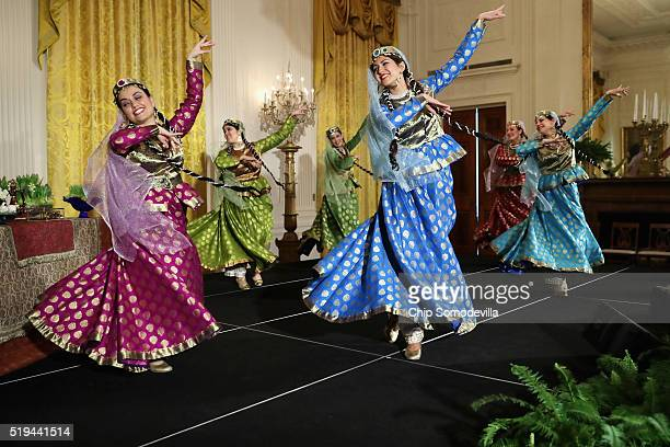 Members of the Nomad Dancers take the stage during a reception marking the Persian new year celebration of Nowruz in the East Room at the White House...