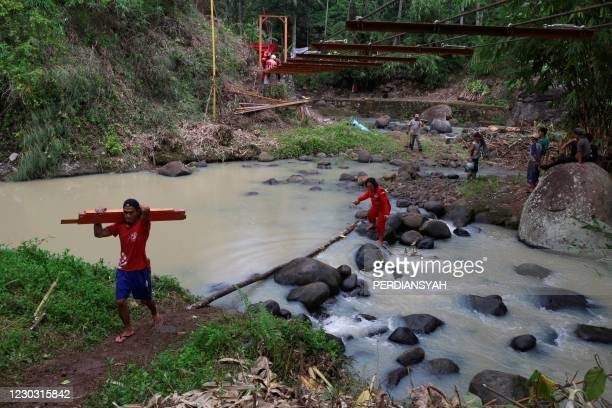 Members of the non-profit organization Vertical Rescue Indonesia help to build a bridge at a village in Bandar Lampung on Indonesia's Sumatra island...