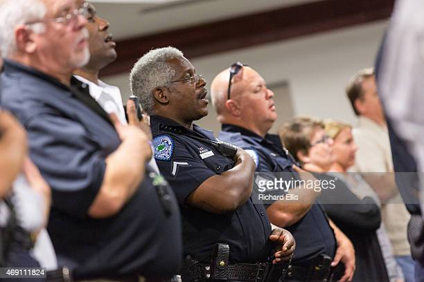 Members of the North Charleston Police department stand for the Pledge of Allegiance before a City Council meeting on April 9 2015 in North...