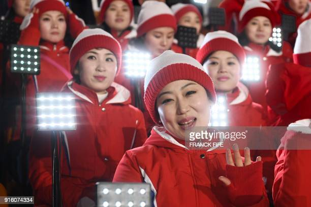 TOPSHOT Members of the North Korean cheering band wave ahead of the opening ceremony of the Pyeongchang 2018 Winter Olympic Games at the Pyeongchang...