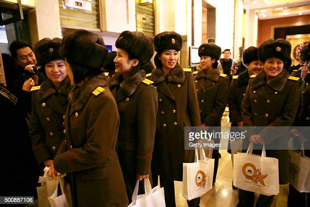 Members of the North Korean female music group Moranbong Band arrive at a hotel after concert rehearsal on December 11 2015 in Beijing China The...