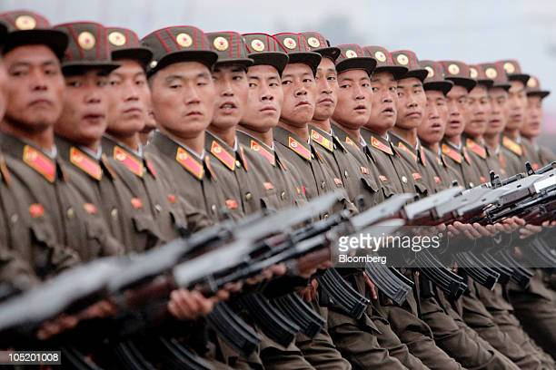 Members of the North Korean military march during a parade commemorating the 65th anniversary of the Korea Worker's Party in Pyongyang North Korea on...