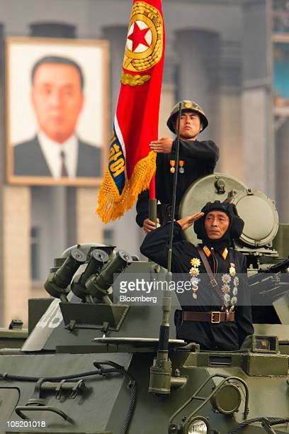 Members of the North Korean military salute during a parade commemorating the 65th anniversary of the Korea Worker's Party in Pyongyang North Korea...