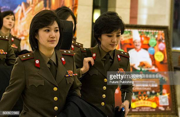 Members of the North Korean State Merited Chorus and the Moranbong Band two famous North Korean performance groups arrive at their hotel on December...
