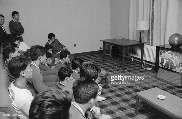 Members of the North Korean World Cup squad watching 'Towed In A Hole' a Laurel Hardy comedy on TV in their hotel The team is in Middlesbrough before...
