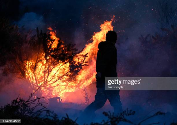 Members of the North Yorkshire Moors Moorland Organisation battle a gorse bush fire on moorland above Guisborough on April 13 2019 in Guisborough...
