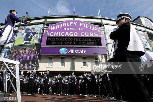 Members of the Northwestern Wildcat band perform before a game between Norfthwestern and the Illinois Fighting Illini played at Wrigley Field on...