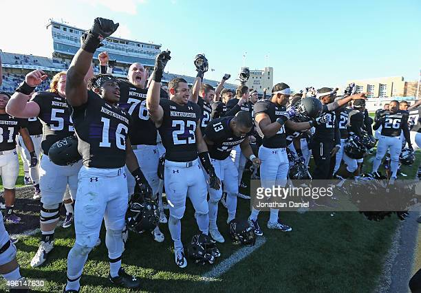 Members of the Northwestern Wildcats celebrate after a win over the Penn State Nittany Lions at Ryan Field on November 7 2015 in Evanston Illinois...