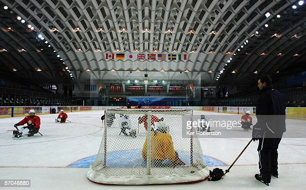 Members of the Norwegian Ice Sledge Hockey team practice during previews to the Turin 2006 Winter Paralympic Games on March 10 2006 at the Torino...