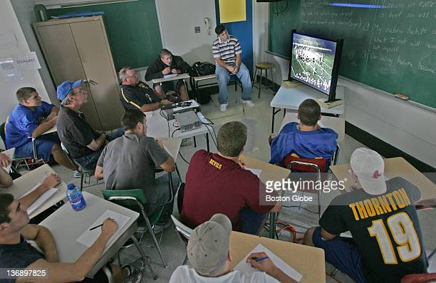 Members of the Norwood High School football team and their coaches watch video footage of a past game Monday afternoon in preparation for an upcoming...