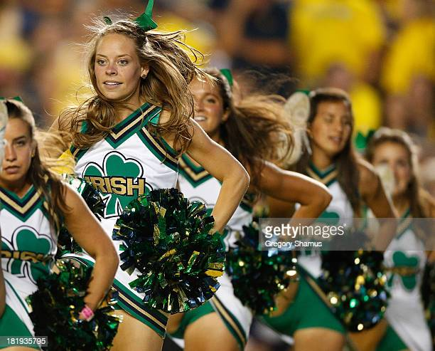 members of the Notre Dame Fighting Irish cheerleading team perform while playing the Michigan Wolverines at Michigan Stadium on September 7 2013 in...