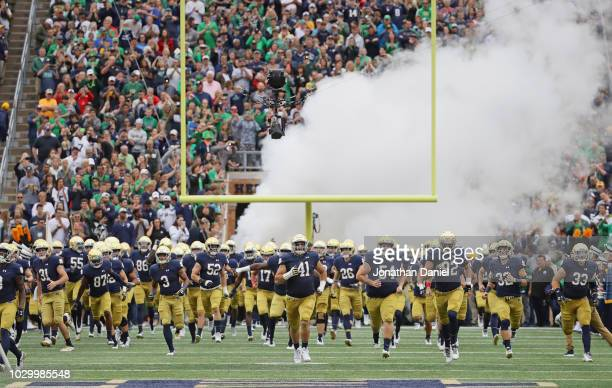 Members of the Notre Dame Fighting Irish enter the field before a game agaoinst the Ball State Cardinals at Notre Dame Stadium on September 8 2018 in...