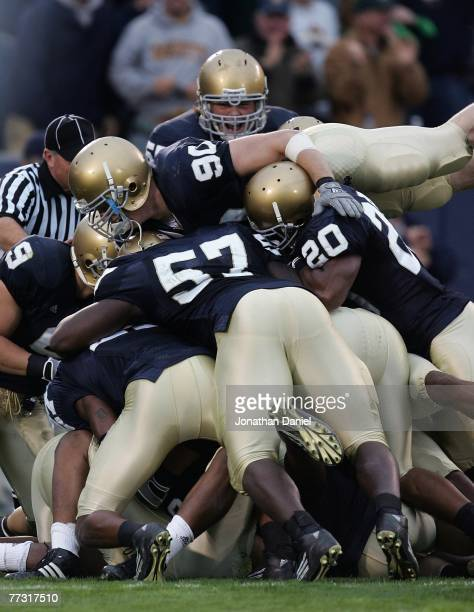 Members of the Notre Dame Fighting Irish including John Ryan Dwight Stephenson and Terrail Lambert are called for a penalty for excessive celebration...