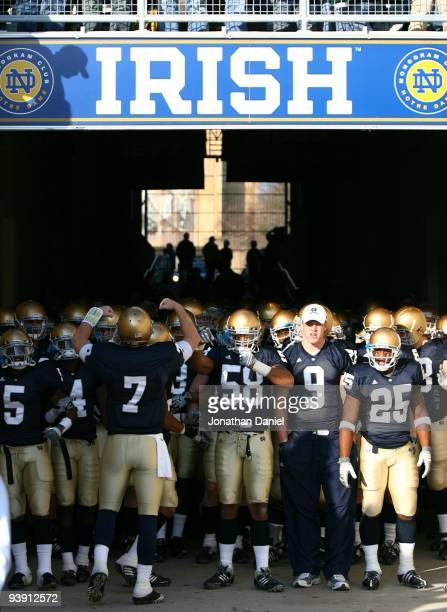 Members of the Notre Dame Fighting Irish wait to walk out of the tunnel before lining up to enter the field for a game against the Univeristy of...
