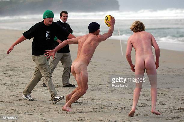 Members of the nude New Zealand team run the ball at the Irish team during a game of touch rugby on St Kilda beach in Dunedin Saturday as the...