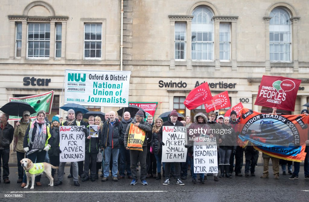 Members of the NUJ, the National Union of Journalists and their supporters strike outside the offices of the Swindon Advertiser in Old Town on January 2, 2018 in Swindon, England. Journalists at the Newquest-owned regional daily have begun two days of strike action over pay and working conditions which also follows a number of recent job cutbacks at the company's Swindon offices.