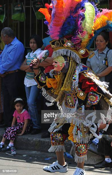 Members of the 'Nure' Guatemalan folk group perform the traditional 'El Torito' dance March 19 2010 during the celebration of Saint Joseph's Day at...