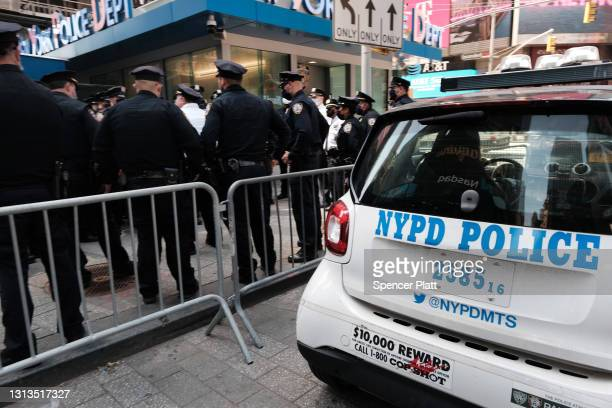 Members of the NYPD congregate in Times Square near a police precinct for a security briefing as security throughout the city is increased ahead of a...