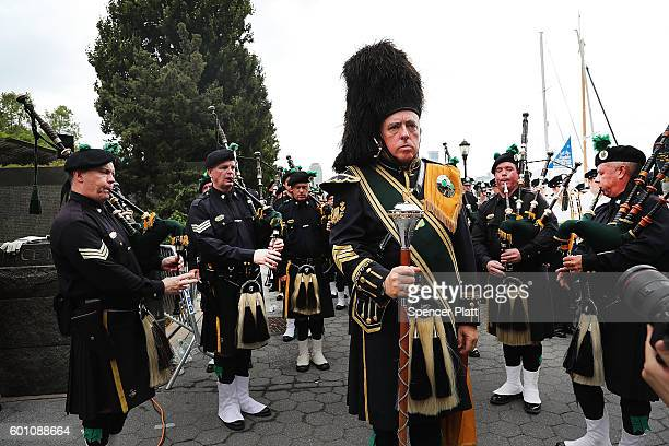 Members of the NYPD Emerald Society Pipes and Drums band pause during a procession in Lower Manhattan to mark the 15th anniversary of the 9/11...