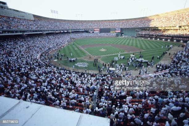 Members of the Oakland A's and San Francisco Giants gather on the field with their familes and security personnel after an earthquake struck prior to...