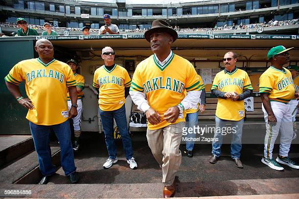 Members of the Oakland Athletics 1981 team Dwayne Murphy Rich Langford Shooty Babbit and Billy Martin Jr stand in the dugout prior to the gmae...