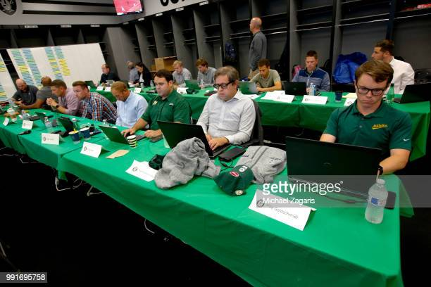 Members of the Oakland Athletics analytics team sit in the Athletics Draft Room on the opening day of the 2018 MLB Draft at the Oakland Alameda...