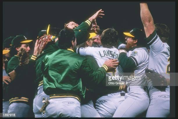 Members of the Oakland Athletics celebrate after a playoff game against the San Francisco Giants