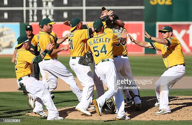 Members of the Oakland Athletics celebrate after defeating the Texas Rangers to win the American League West at Oco Coliseum on October 3 2012 in...