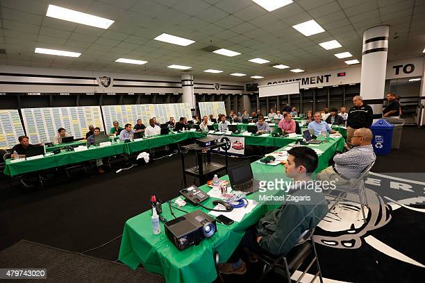 Members of the Oakland Athletics draft team sit in the Athletics draft room prior to making their first pick during the first day of the 2015 MLB...