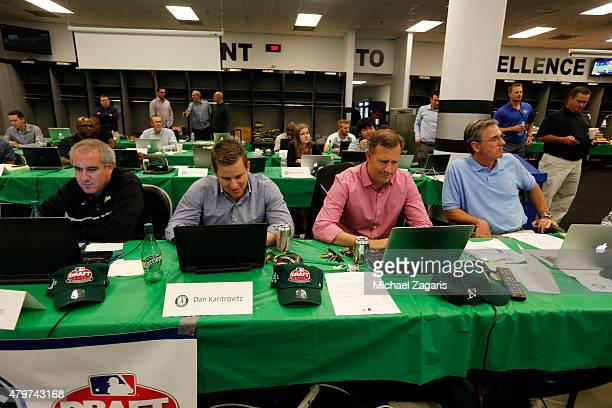 Members of the Oakland Athletics draft team work in the Athletics draft room during the first day of the 2015 MLB Draft at Oco Coliseum on June 8...
