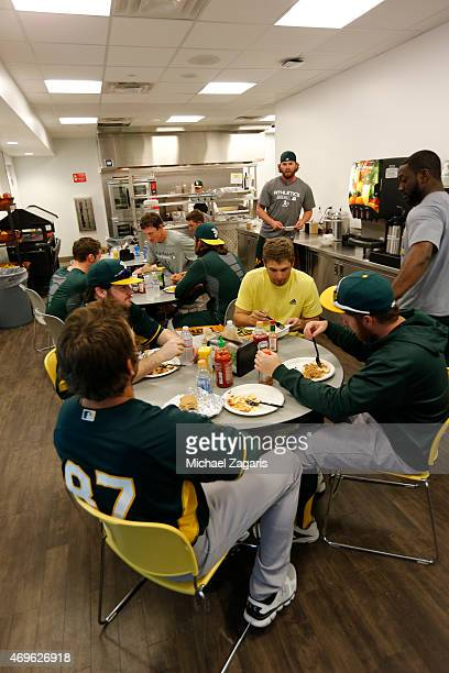 Members of the Oakland Athletics enjoy lunch in the clubhouse prior to the game against the San Francisco Giants at Scottsdale Stadium on March 4...