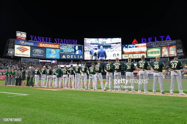 Members of the Oakland Athletics line up for the national anthem the American League Wild Card game against the New York Yankees at Yankee Stadium on...